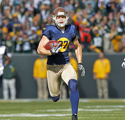Jordy Nelson is in the open field and won't be caught as he scores a career-best 93-yard touchdown. (AP)