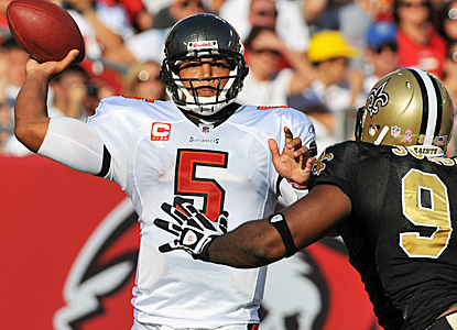 Josh Freeman throws for 303 yards and two touchdowns with no picks to help his team move into a first place tie. (Getty Images)