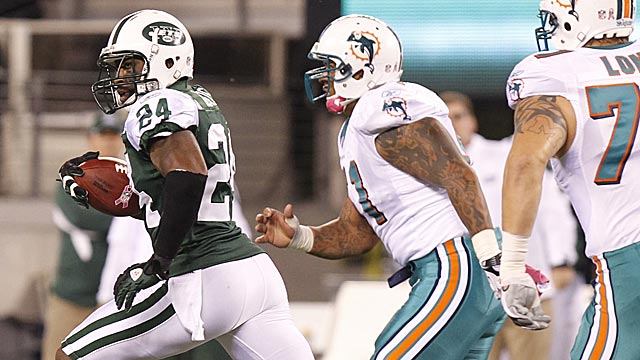 Darrelle Revis takes a pick to the house Monday night after mugging Brandon Marshall. (US Presswire)
