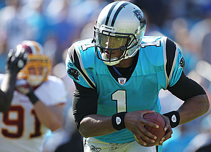 Rookie QB Cam Newton is the story for the Panthers, throwing for 256 yards and running for 59 more. (Getty Images)