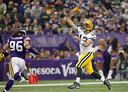 Aaron Rodgers throws for 335 yards and three touchdowns to keep his Packers undefeated. (AP)