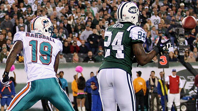Brandon Marshall was grabbed before Darrelle Revis snagged a pick-6 on a key Week 6 play. (US Presswire)