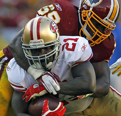 The Redskins fail to contain RB Frank Gore, who produces his fifth consecutive 100-yard game.  (AP)