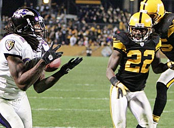 Torrey Smith (82) beats William Gay (22) and Ryan Clark (25) for the game-winning touchdown. (US Presswire)