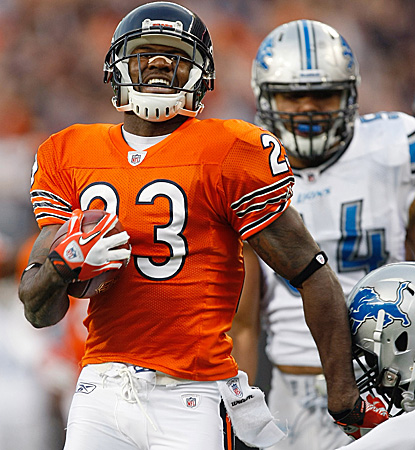 Devin Hester returns another punt to the house to extend his NFL record in a laugher over the Lions. (Getty Images)