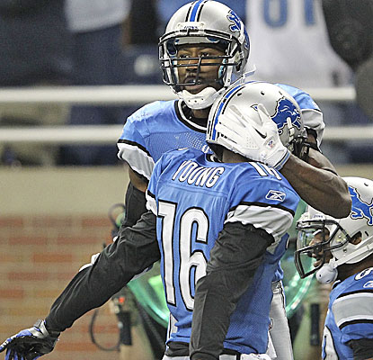 Nate Burleson celebrates a touchdown reception from Matthew Stafford, who passes for five on the day.     (Getty Images)