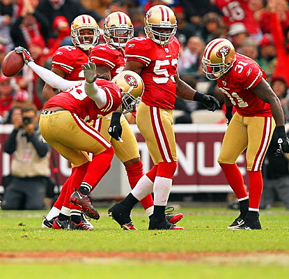 The 49ers' Dashon Goldson (left) celebrates an interception with teammates in the third quarter. (Getty Images)