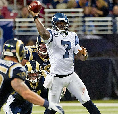 Tarvaris Jackson doesn't get much going in the air against St. Louis but still leads Seattle to a victory. (US Presswire)