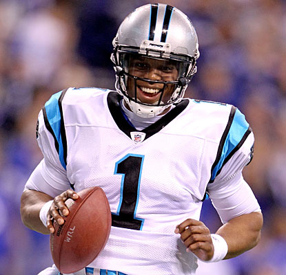 Cam Newton celebrates after his 10th rushing TD of the season, two shy of the NFL record for quarterbacks.  (Getty Images)