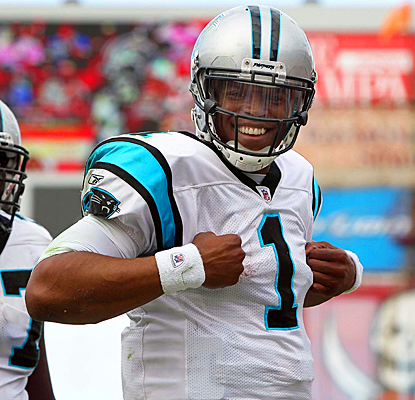 Cam Newton smiles after scoring one of his three rushing touchdowns against Tampa Bay. (US Presswire)