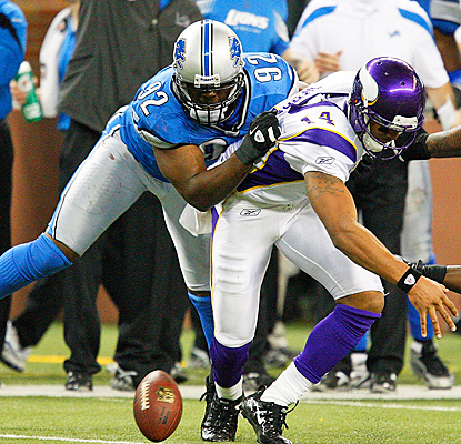 Detroit's Cliff Avril forces Minnesota's Joe Webb to fumble on the final play of the game. (Getty Images)