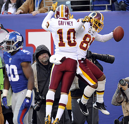Jabar Gaffney goes airborne to help Santana Moss celebrate his 20-yard touchdown reception.  (AP)