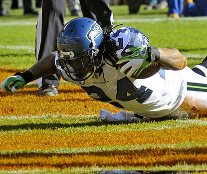 Marshawn Lynch eclipses 1,000 rushing yards and scores twice, extending his touchdown streak to 10 games.  (US Presswire)