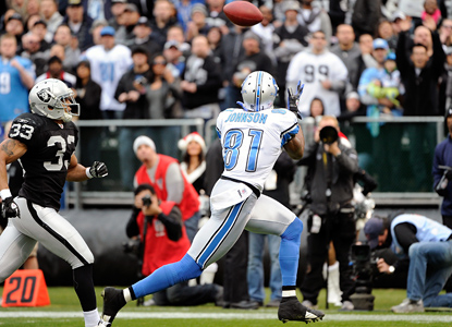 Calvin 'Megatron' Johnson goes for 214 yards on 9 catches to help the Lions extend their wild-card lead. (Getty Images)