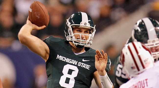 MSU's Kirk Cousins might not be viewed as a first-rounder, but he is on many scouts' radars. (Getty Images)