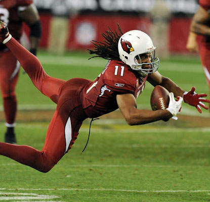 Larry Fitzgerald's diving, one-handed catch in overtime sets up the winning field goal for Arizona.  (Getty Images)