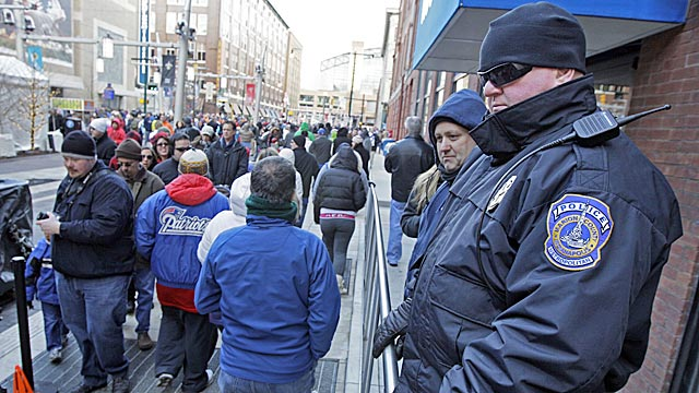 An Indianapolis police officer watches the crowd at the Super Bowl village. (AP)