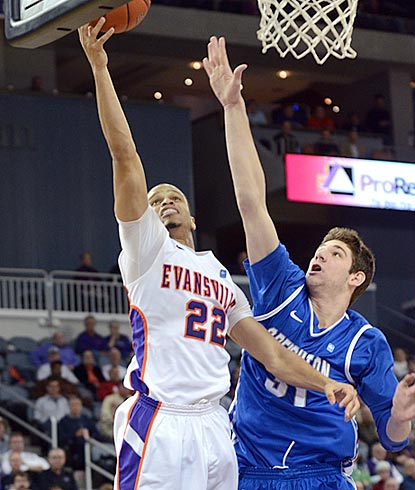 Evansville guard Ned Cox goes up for a shot against Creighton's Will Artino during the second half.  (AP)
