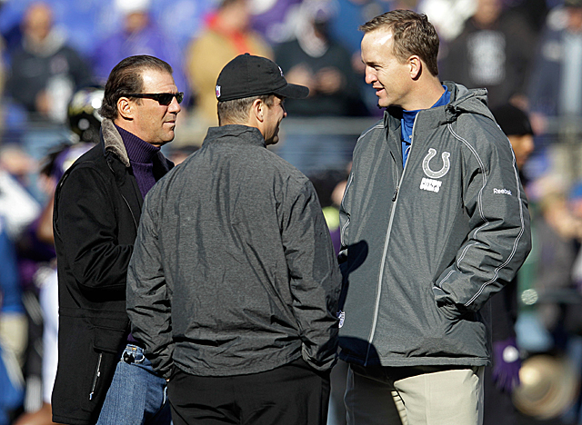 Peyton Manning chats with Ravens officials before the Colts game in Baltimore this season. (Getty Images)