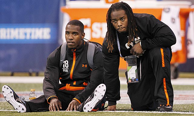 Top RB prospects Lamar Miller (left) and Trent Richardson can expect a long wait on Day 1 of the draft. (AP)
