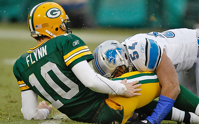 Matt Flynn showed impressive toughness and mobility against a fierce Lions pass rush. (Getty Images)