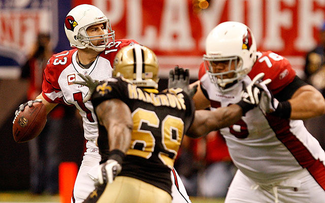 Kurt Warner quit playing after taking several big hits vs. the Saints in the 2009 playoffs. (Getty Images)