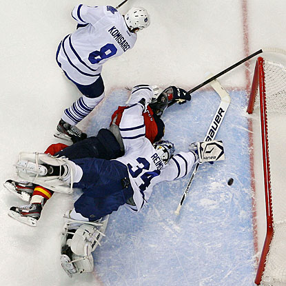 Goalie James Reimer tries to defend the net as Tomas Kopecky (on ice) gets a power-play goal. (Getty Images)
