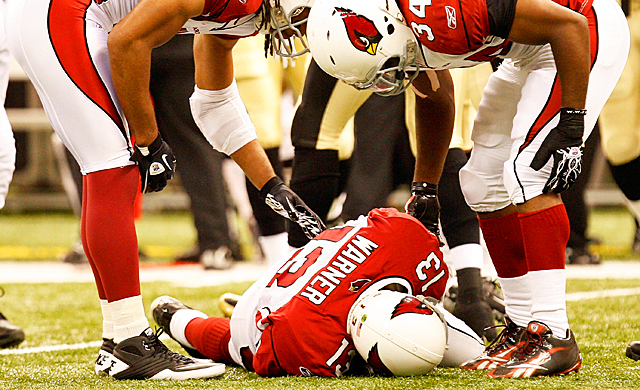 Former Cardinals quarterback Kurt Warner is hurt after taking a hit against the Saints in 2010. (Getty Images)