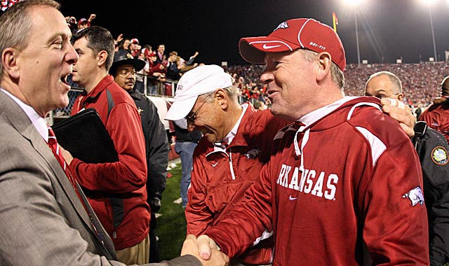 AD Jeff Long (left) could have saved Bobby Petrino from himself. (Getty Images)
