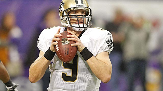 Brees broke Dan Marino's passing mark in 2011, throwing for 5,476 yards and 46 TDs. (US Presswire)