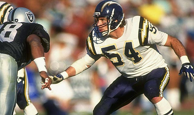 Smith (54) says Seau was the 'best defender to put on that uniform.' (Getty Images)