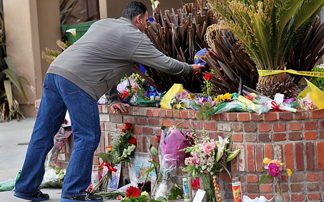 Fans have turned the outside of Junior Seau's California home into a memorial shrine. (Getty Images)
