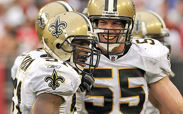 Fujita (55) celebrates Jonathan Vilma interception when the two were Saints teammates. (US Presswire)