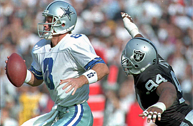 Smith, a defensive end with the Raiders from 1991 to 1998, chases down Troy Aikman. (Getty Images)