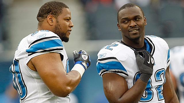 Ndamukong Suh (left) has often made the wrong kinds of headlines; Cliff Avril (right) has not. (Getty Images)