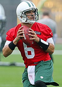 Mark Sanchez now has more pressure with Tim Tebow behind him. (US Presswire)