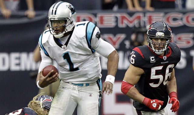 Cam Newton 'could easily rush for 1,000 yards this year as Michael Vick did in 2006.' (Getty Images)