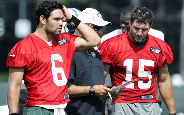 Mark Sanchez says he has bigger things to worry about than Tim Tebow, who is 'here to help us.' (AP)