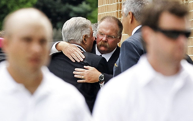 Eagles coach Andy Reid greets people attending his son Garrett's funeral. (AP)