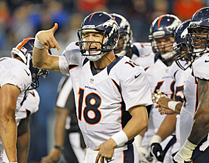 Peyton Manning makes his Broncos debut and it's shaky, throwing an interception in limited action. (AP)