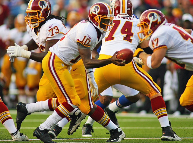The Redskins keep it simple on offense for Robert Griffin III in his preseason debut and he plays well. (AP)