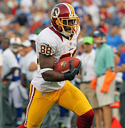 Pierre Garcon catches three passes for 58 yards, including a 20-yard TD reception. (US Presswire)