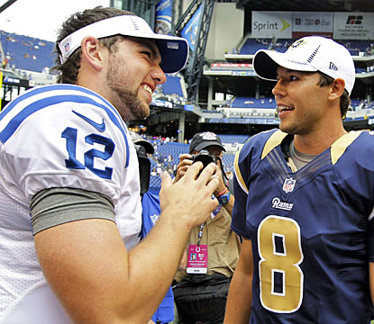 Andrew Luck shares a postgame moment with 2010 No. 1 pick Sam Bradford, who can't keep up in the preseason opener.  (AP)