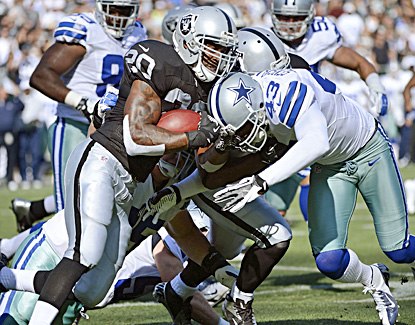 Darren McFadden looks like he's ready to start the season after gaining 38 yards on Oakland's first three plays of the game. (Getty Images)