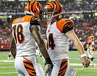 Andy Dalton (right) celebrates with receiver A.J. Green after the two connect on a 50-yard touchdown. (US Presswire)