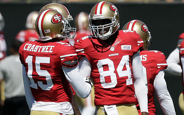 Worried about Michael Crabtree learning from Randy Moss? So far, so good, say the Niners. (AP)
