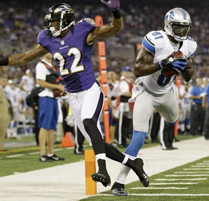 Calvin Johnson hauls in an 18-yard touchdown over Jimmy Smith and finishes the night with 111 receiving yards.  (AP)