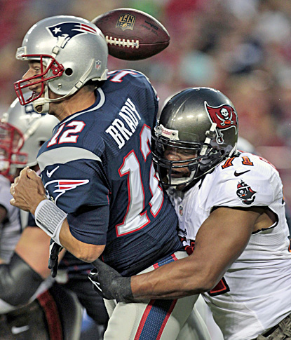 It's a rough outing for Tom Brady, who loses the ball as he is hit by Tampa Bay's Michael Bennett.  (AP)