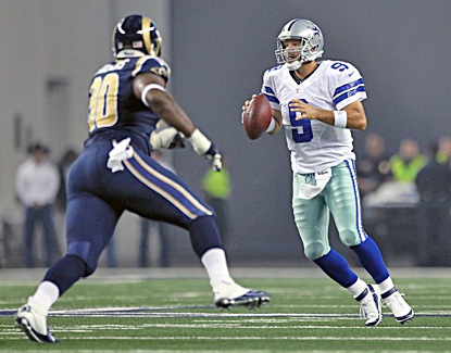 Tony Romo, looking downfield to pass, connects with Dwayne Harris twice for touchdowns against the Rams. (US Presswire)