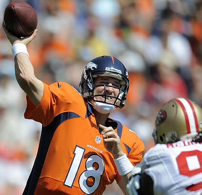 Peyton Manning finishes 10 of 12 for 122 yards and throws two touchdowns, both to WR Eric Decker. (AP)
